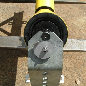Weigh idler showing adjustable cam.